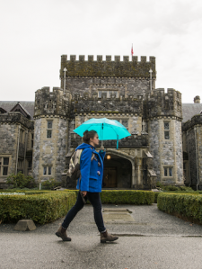 woman with umbrella in front of Hatley Castle