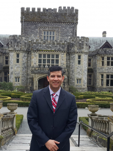 Man in suit in front of Hatley Castle