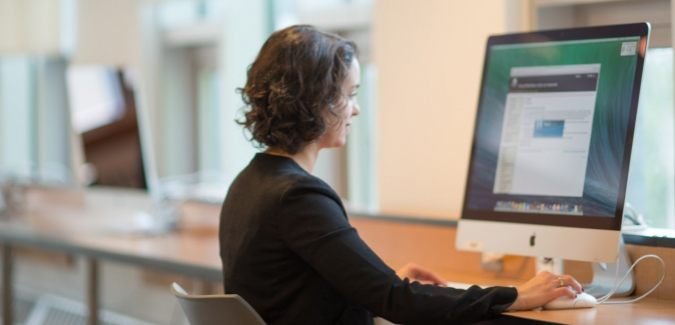 Picture of a woman on a computer