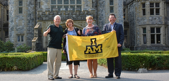 President Allan Cahoon, Dean Brigitte Harris, Military Liaison Shelley Langille, and VP Pedro Marquez with CFB Esquimalt's 2017 Invictus Games Flag