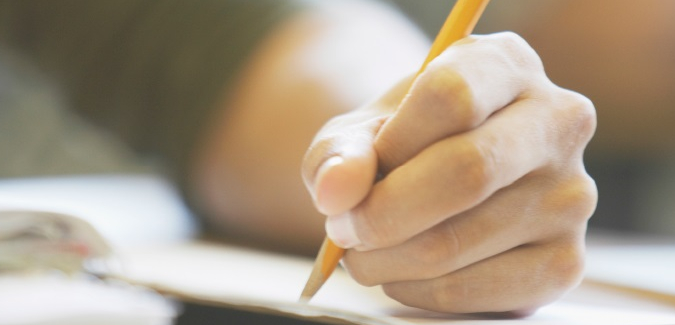 Hand holding yellow pencil