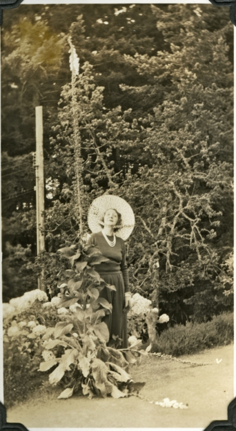 Muriel with hollyhocks2 at Journey's end, McCann Collection, RRU Archives